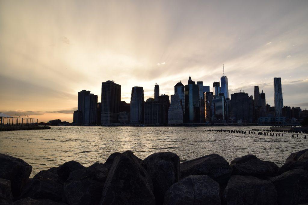sunrise behind cityscape