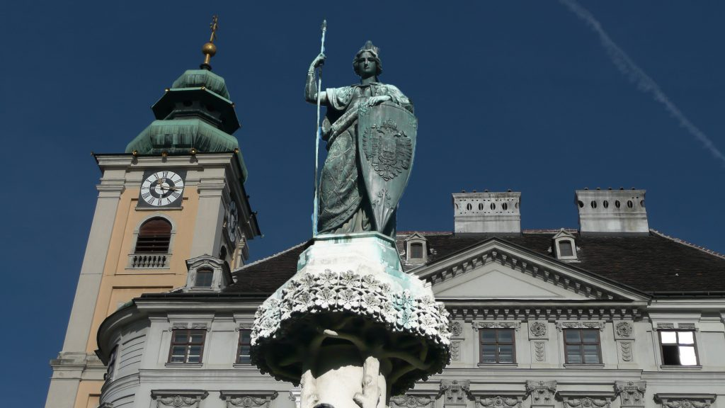 female statue with crown on fountain as Austria allegory
