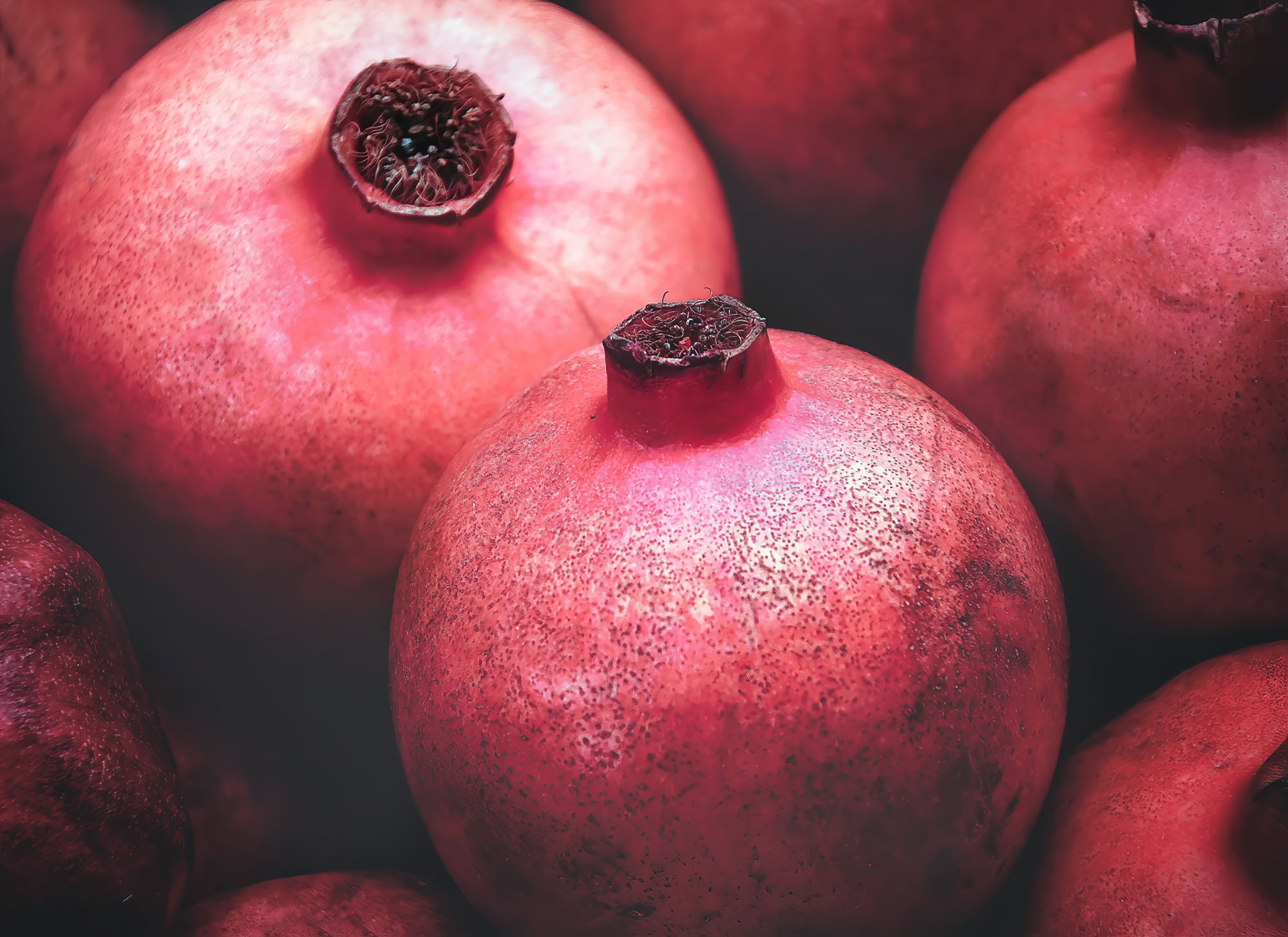 photo of unpeeled pomegrantes